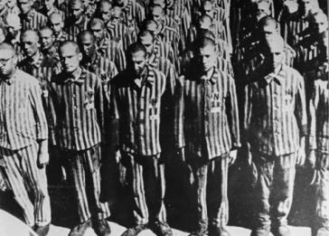 "Dutch Jewish prisoners stand at roll call shortly after their arrival on February 18, 1941, at Buchenwald. The letter ""N"" stands for Netherlands."