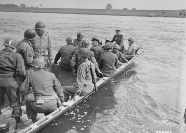 Maj. Gen. Clarence R. Huebner, CG of the V Corps, and Russian Maj. Gen. Pusacof, 58th Inf. Div. , Russian Army , with their staffs, cross the Elbe River for a conference with the CG of the Russian 34th Corps
