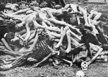 The bodies of former prisoners are piled outside the crematorium at the newly liberated Dachau concentration camp. Dachau, Germany, April-May 1945. <i>US Holocaust Memorial Museum, courtesy of Marcy Haupsman</i>