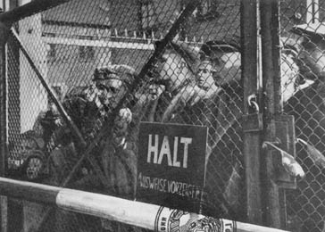 Survivors at the gate to the Auschwitz concentration camp.