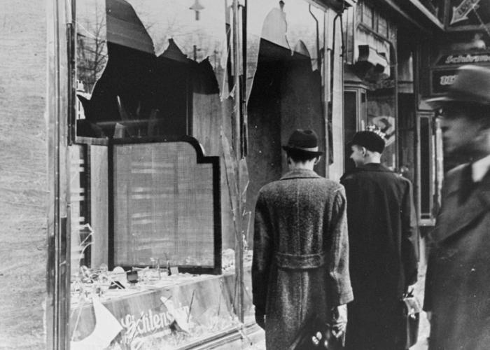 Germans view the damage caused to a Jewish-owned store in Berlin. November 10, 1938.