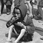 An emaciated child on the street in the Warsaw ghetto.