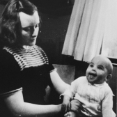 Dutch rescuer Marion Pritchard poses with the Jewish infant, Erica Pollak, whom she was hiding.