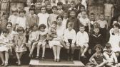Portrait of children at a Jewish summer camp. Pictured in the center is Gerd Zwienicki. In front of him is Hannah Steinberg.