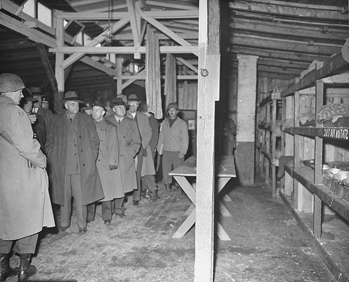 Members of a US Congressional committee investigating Nazi atrocities walk through a prisoner barracks in the newly liberated Buchenwald concentration camp