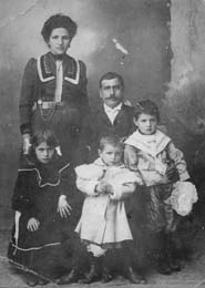 Portrait of an Armenian family. Pictured are Elbis Jeknavorian, Ohanjan Chitjian and their three children. Ordu, Ottoman Empire (now Turkey), 1905.