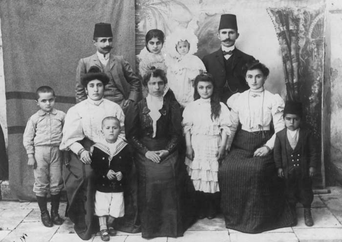 Portrait of an Armenian family. Pictured are the Selian and Gulbenkian families. A nursemaid holds the baby. Mersin, Ottoman Empire (now Turkey), 1906.
