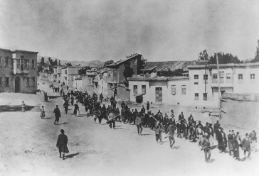 Ottoman military forces march Armenian men from Kharput to an execution site outside the city.  Photograph taken by Armin T. Wegner. Wegner served as a nurse with the German Sanitary Corps. In 1915 and 1916, Wegner traveled throughout the Ottoman Empire and documented atrocities carried out against the Armenians. Kharput, Ottoman Empire (now Turkey), March–June 1915.