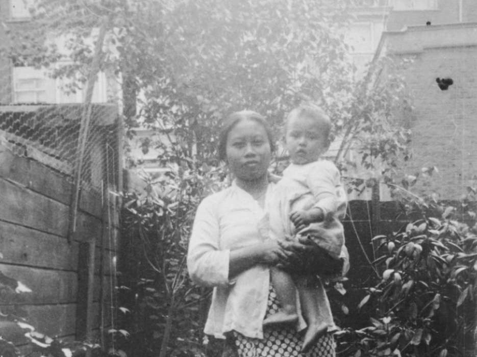 Mima Saina poses with Alfred Münzer, a Jewish child who is living in hiding in the home of her employer, Tole Madna.