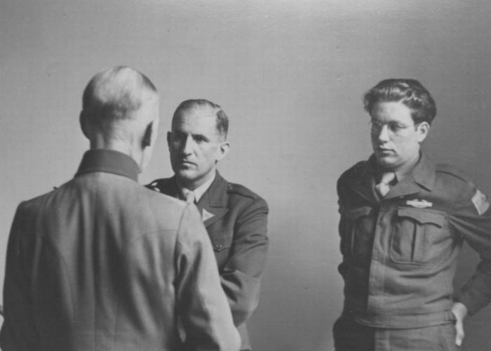 German Field Marshall Gerd von Rundstedt speaks to American prosecutor Robert Kempner (left) and interpreter Gerald Schwab during a pause at the IMT Nuremberg commission investigating the Supreme Command of the German Armed Forces.