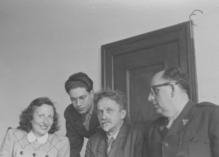 Interpreters working for the IMT Nuremberg commission investigating indicted Nazi organizations pose with Russian prosecutor Colonel Orlov. Among those pictured are Freudenthal, Lowenstein, and Gerd Schwab.