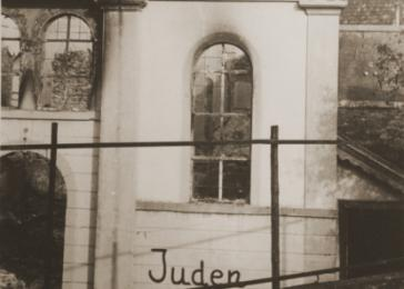 "The word ""Jews"" is scrawled on the exterior wall of the destroyed synagogue in Buehl. The synagogue was burned during Kristallnacht."