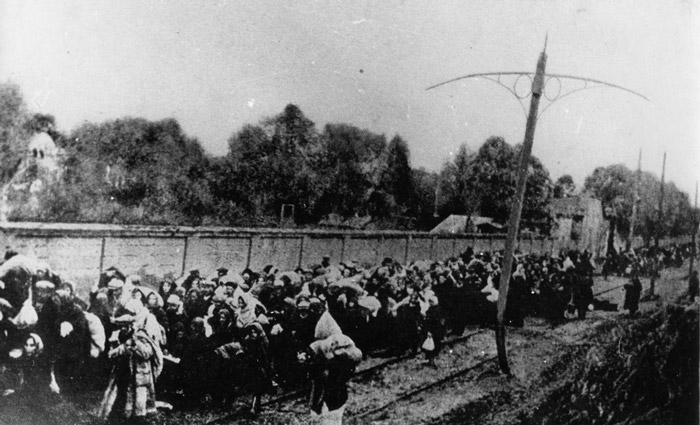 Hungarian gendarmerie round up Jews in Budapest and march them toward Hegyeshalom at the Austrian border. Hungary, November 1944.