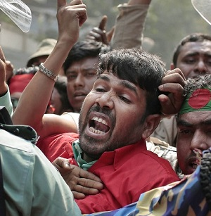 Protesters try to break through a police barricade during a demonstration against a strike called by the opposition in Dhaka, Bangladesh. February 9, 2015.