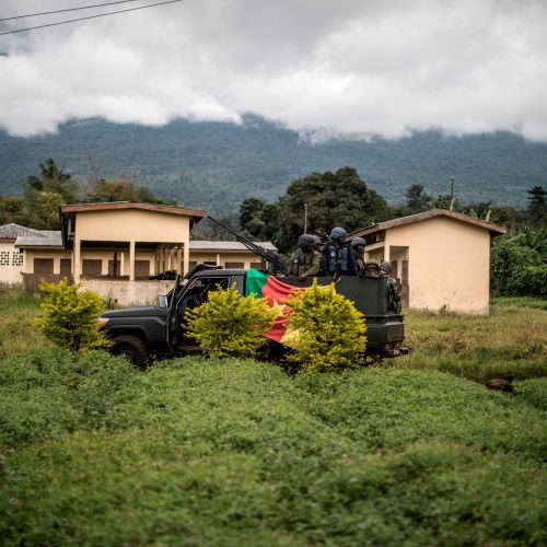 An armoured pick up of the Cameroonian army secures the perimeter of a polling station in Lysoka, near Buea, Southwestern Cameroon, on October 7, 2018 during the presidential election.