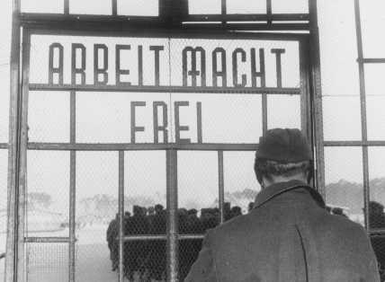 """Work makes one free,"" a sign on the gate at Sachsenhausen concentration camp. Germany, February 1941."