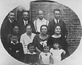 Mordecai Gebirtig, second from right, top row, with family and friends. Cracow, Poland, 1924.