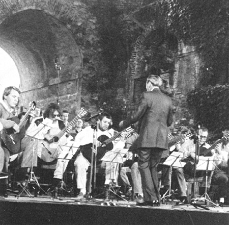 Dr. Herbert Zipper conducts the 50th anniversary performance of Dachau Song at the Autumn Festival. Graz, Austria, September 23, 1988.