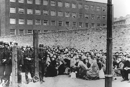 Jews assembled under guard before deportation from Warsaw. Warsaw, Poland, July-September 1942.