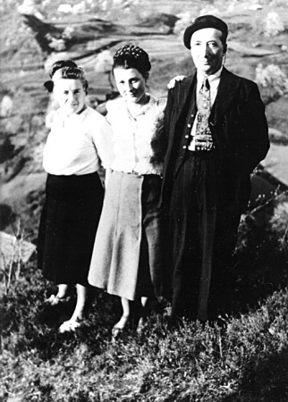 Simone Arnold Liebster (middle) poses for a photograph with her parents, Emme and Adolphe Arnold, 1947.