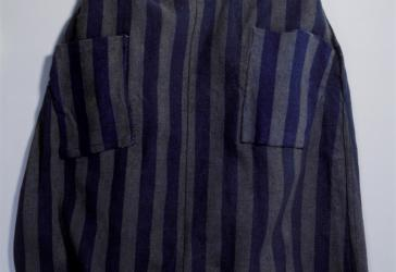The striped skirt of a prison uniform worn at the Auschwitz concentration camp.
