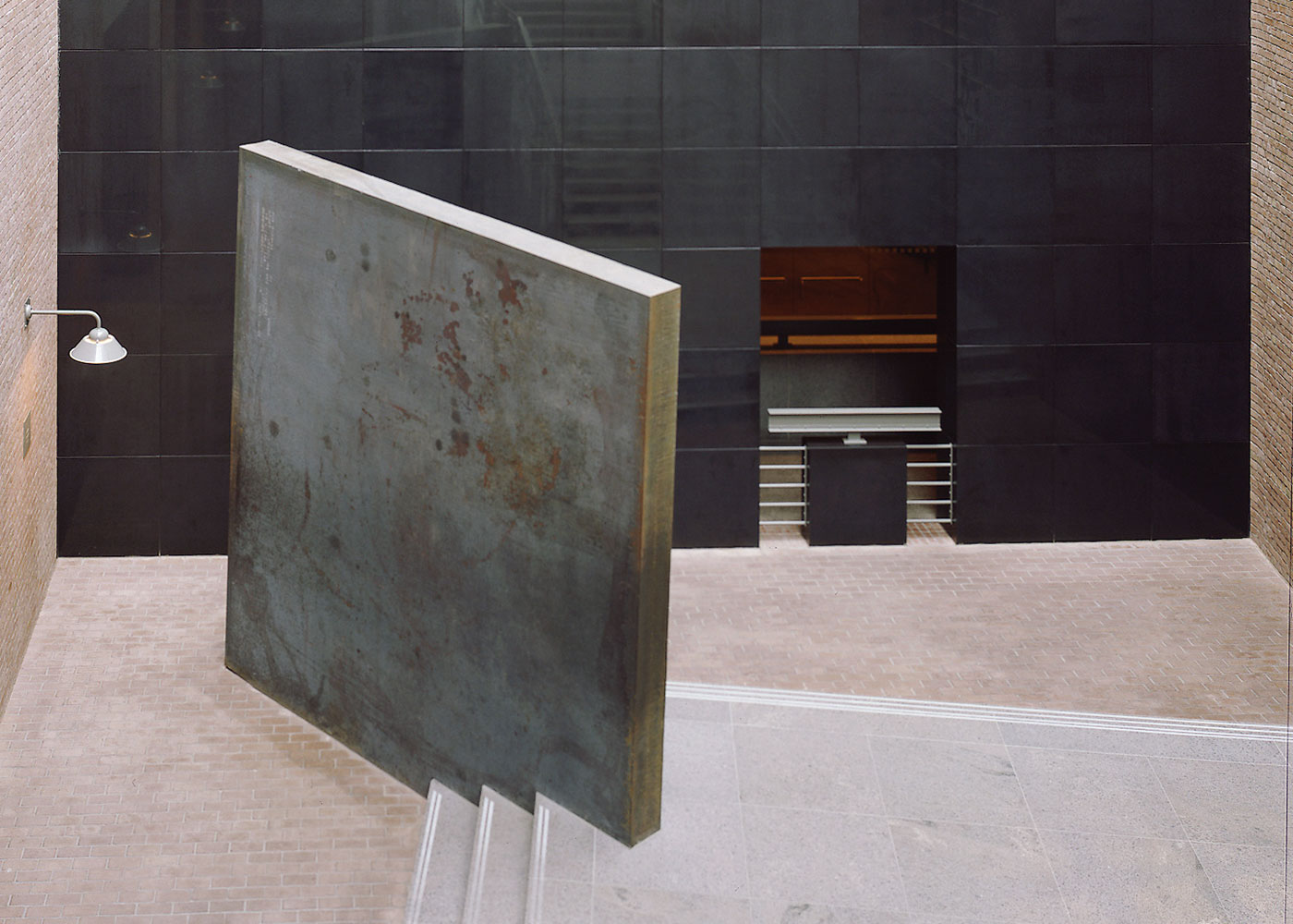 Richard Serra's sculpture <i>Gravity</i> is wedged into the staircase in the southwest corner of the Hall of Witness.