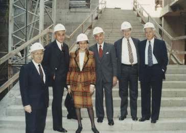 Miles Lerman (far left) stands before the grand staircase in the Hall of Witness during construction of the Museum. Washington, DC, 1991. <i>US Holocaust Memorial Museum</i>