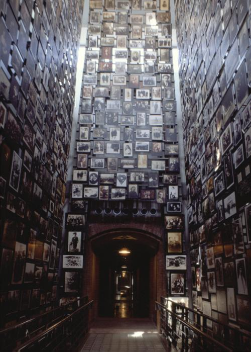 This three-story tower in the Museum's Permanent Exhibition displays photographs from the Yaffa Eliach Shtetl Collection.