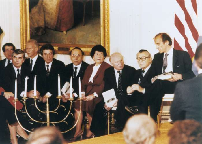 Miles Lerman (seated, center) takes part in the first Days of Remembrance ceremony, held in the East Room at the White House. Participants included President Ronald Reagan, Hadassah Rosensaft, Benjamin Meed, and Elie Wiesel. Washington, DC, April 18, 1981. <i>US Holocaust Memorial Museum</i>