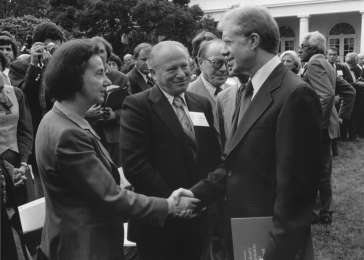 Vladka and Benjamin Meed with President Jimmy Carter at a White House ceremony marking the presentation of the report of the US Holocaust Commission to the president. Washington, DC, September 27, 1979. <i>US Holocaust Memorial Museum, courtesy of Jimmy Carter Library</i>
