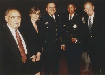 Chairman Miles Lerman (far left), Director Sara Bloomfield, DC Police Chief Charles Ramsey (center), and Abe Pollin (far right) gather at the Museum&#8217;s Law Enforcement and Society: Lessons of the Holocaust program. <i>US Holocaust Memorial Museum, courtesy of Marshall Cohen</i>