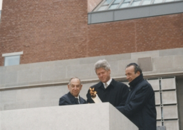 "Chairman Harvey M. ""Bud"" Meyerhoff, President Bill Clinton, and Founding Chairman Elie Wiesel light the eternal flame during the Museum's dedication ceremony on April 22, 1993."