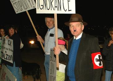 Man dressed as Adolf Hitler protesting the burning of <i>Harry Potter and the Sorcerer's Stone</i> in Alamogordo, New Mexico, December 30, 2001. <i>W. David Buckley</i>