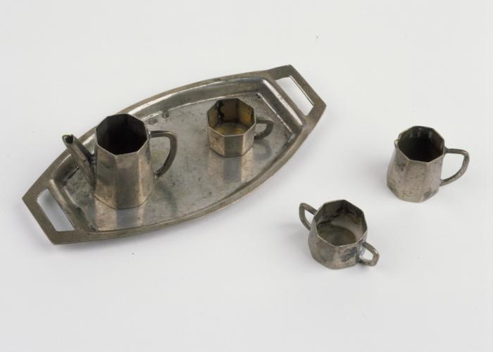 A five-piece miniature silver tea set given to Elzbieta Lusthaus by her grandmother prior to moving into the Tarnow ghetto.