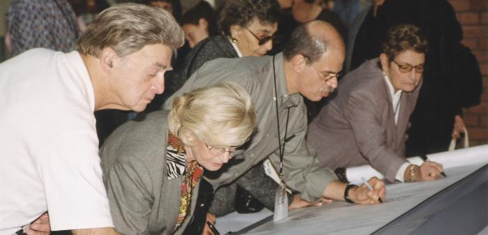 "Attendees signing the scroll during the U.S. Holocaust Memorial Museum ""Tribute to Survivors: A Reunion of a Special Family,"" November 1-2, 2003."