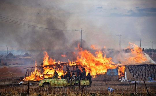 The town of Abyei is looted and burned following its takeover by Sudanese Government forces. UN photo/Stuart Price/May 2011.