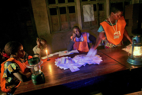 Election officers count votes late into the night after elections in Bunia, DRC. October 29, 2006. UN Photo/Martine Perret