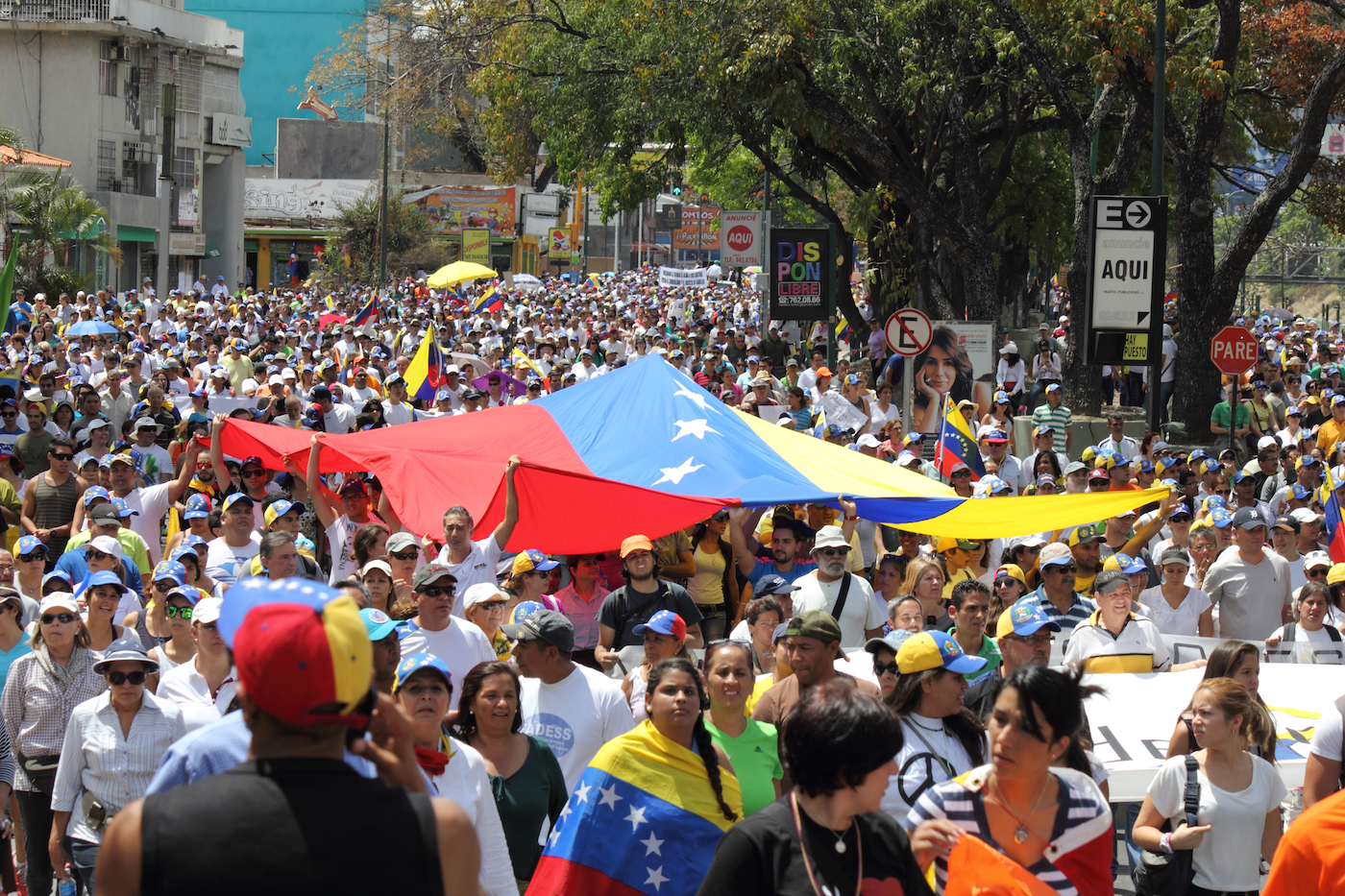 Venezuelans protest in the street against the government for human rights violations and killings of civilians in peaceful demonstrations. March 16, 2014.