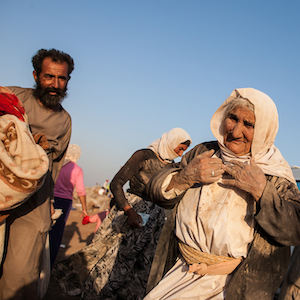 This Yezidi woman, age 85, walked for five days to escape from Mount Sinjar in 2014. She took a van for the last kilometer to a refugee camp across the border in Syria.