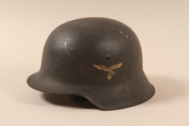 1985.1.3 left side Luftwaffe M1942 helmet taken from a German soldier by US soldier