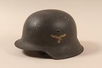 1985.1.3 left side Luftwaffe M1942 helmet taken from a German soldier by US soldier  Click to enlarge