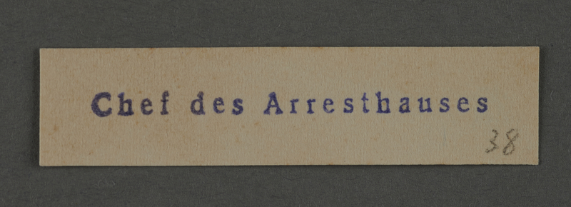 1995.89.1011 front Department stamp impression for the Chief of the Jail in the Kovno ghetto