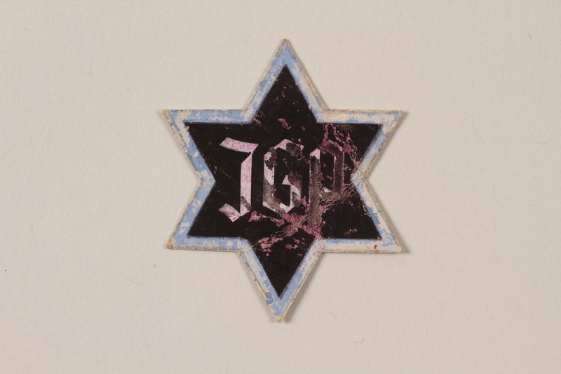 1995.89.1080 front Jewish Ghetto Police badge from the Kovno ghetto