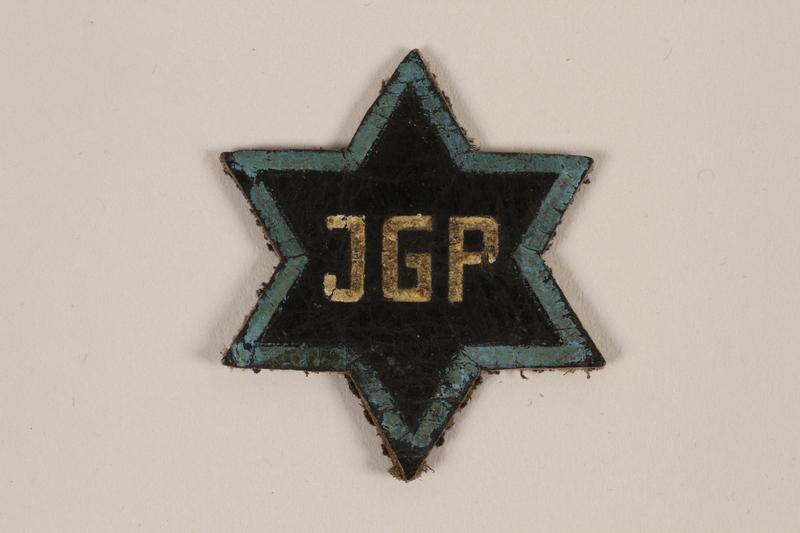 1995.89.1081 front Jewish Ghetto Police badge from the Kovno ghetto