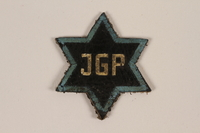 1995.89.1081 front Jewish Ghetto Police badge from the Kovno ghetto  Click to enlarge