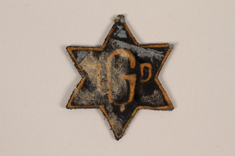 1995.89.1082 front Jewish Ghetto Police badge from the Kovno ghetto