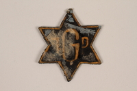 1995.89.1082 front Jewish Ghetto Police badge from the Kovno ghetto  Click to enlarge