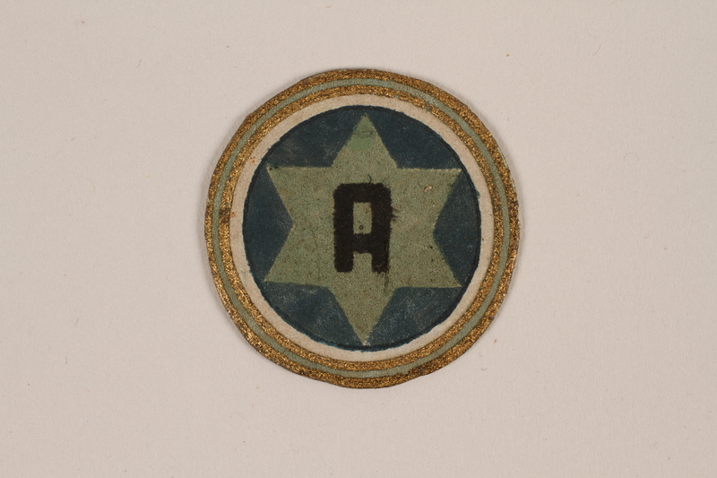1995.89.1083 front Circular leather Star of David badge worn in the Kovno Ghetto