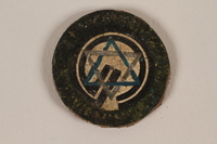 1995.89.1084 front Jewish Ghetto Police badge from the Kovno ghetto  Click to enlarge