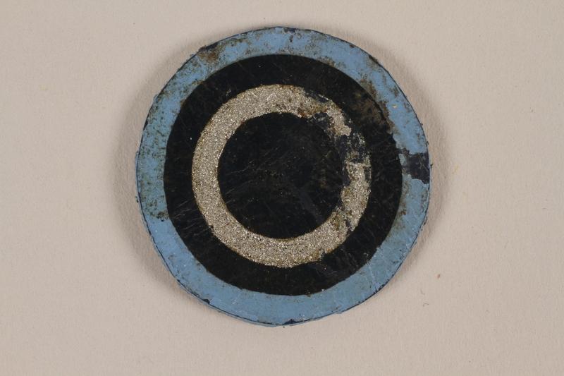 1995.89.1085 front Jewish Ghetto Police insignia from the Kovno ghetto